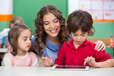 Teacher and kids using tablet